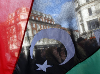 Demonstrators shout during a protest against Libyan leader Gaddafi in Dublin
