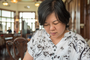 Asian women look menu in coffee shop vintage style
