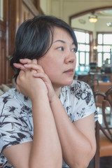 Asia women thao chin in coffee shop vintage style