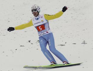 Switzerland's Simon Ammann reacts after his jump of the second event of the four hills ski jumping tournament in Garmisch-Partenkirchen