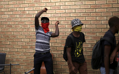 A protester reacts as he distrupts lectures during protests demanding free tertiary education at the North-West University in Vanderbijlpark