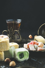 Tea in a glass and Oriental sweets on a tray