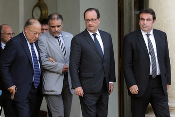 French President Hollande and representatives of religious communities leave after a meeting at the Elysee Palace in Paris