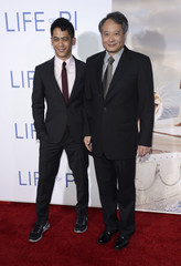 """Lee Ang and son Mason Lee attend a special screening of the film """"The Life of Pi"""" in Los Angeles"""