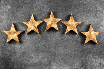 Five stars on dark background