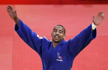 France's David Larose celebrates after defeating Cho Jun-ho of South Korea in their under-66 kg final at the Paris International Grand Slam judo tournament