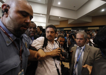 U.N. security arrest Reuters photographer Jorge Silva for photographing the arrest of activists in Cancun