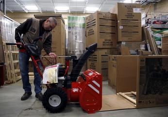 Troy-Bilt representative Bowles assembles snow blower Lowe's store in Kentlands Maryland