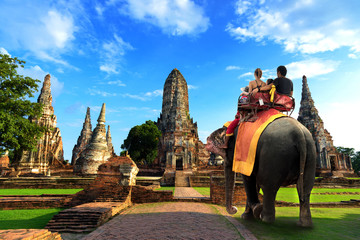 Thailand travel concept ride elephant at temple wat chai watthanaram
