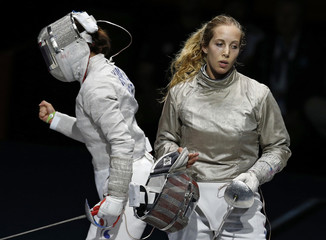 South Korea's Jiyeon Kim celebrates her victory against Mariel Zagunis of the U.S. at the end of their women's sabre individual semifinals fencing competition during the London 2012 Olympic Games