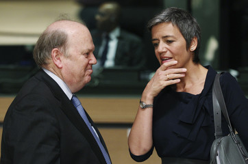 Ireland's Finance Minister Noonan listens to Danish Economy Minister Vestager during an EU finance ministers meeting in Luxembourg