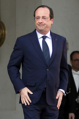 French President Francois Hollande waits for a guest on the steps of the Elysee Palace in Paris