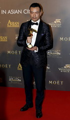 Chinese actor Liao Fan poses after winning the Best Actor award at the Asian Film Awards in Macau