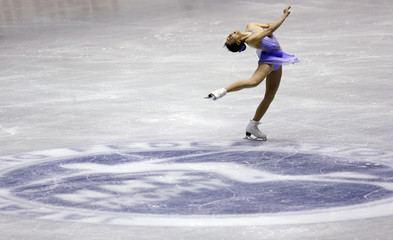 Asada of Japan performs during the women's short programme at the ISU Grand Prix of Figure Skating in Tokyo