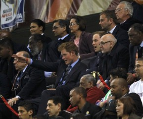 Britain's Princes William and Harry watch the 2010 World Cup Group C soccer match between England and Algeria at Green Point stadium in Cape Town