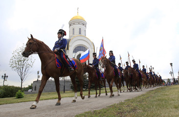 Russian Cossacks ride during beginning of march to Paris, France, dedicated to anniversary of Patriotic War of 1812, in Moscow