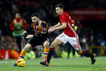 Hull City's Robert Snodgrass in action with Manchester United's Matteo Darmian