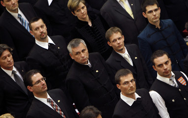 Hungarian far-right Jobbik party leader Gabor Vona, wears an outfit of the dissolved Hungarian Guard movement as he takes the official oath as members of the new parliament in Budapest