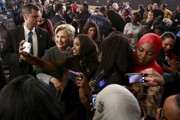 """U.S. Democratic presidential candidate Hillary Clinton takes a selfie with a supporter after speaking at the """"Women For Hillary"""" Town Hall event in the Brooklyn borough of New York"""