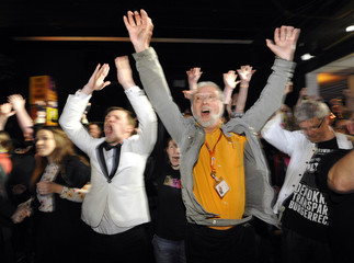 Supporters of Die Piraten (The Pirates) party react after first exit polls for the federal state elections of Germany's northern state of Schleswig-Holstein in Kiel