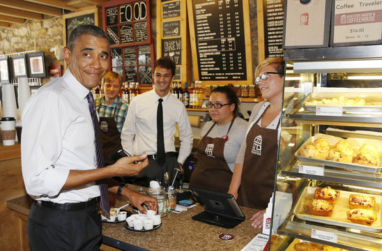 U.S. President Barack Obama orders an iced tea while in Parkville Coffee shop on Main Street in Parkville, Missouri