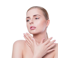 Beauty woman portrait. Beautiful spa model girl with perfect Fresh Clean Skin and natural professional makeup. Blonde female crossing hands showing ideal manicure. Youth and Skin Care Concept. Over