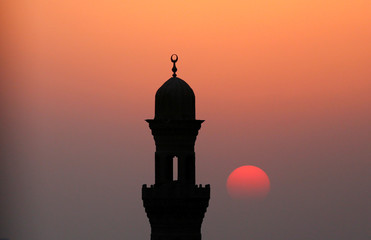 A minaret of a mosque is pictured during sunset on the first day of the New Islamic Hijri year 1438 in old Islamic Cairo