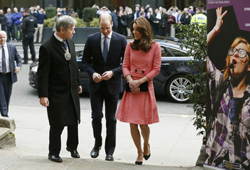 Britain's Prince William and his wife Catherine, Duchess of Cambridge, arrive for an XLP project visit in London