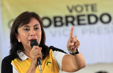 Philippine Vice-presidential candidate and congresswoman Leni Robredo gestures as she  talks to her supporters during a campaign rally in Quezon City, Metro Manila