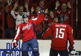 Chimera of the Capitals celebrates his goal against the Penguins with teammate Halpern during their NHL hockey game in Washington
