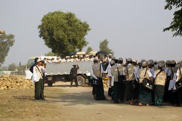 Volunteers arrive at a Rohingya village in Sittwe during a national census in Myanmar