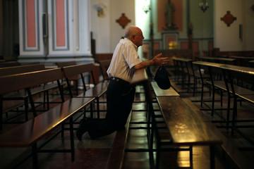 A man prays at El Socorro church in the Andalusian city of Ronda