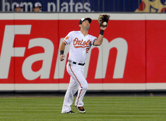 Baltimore Orioles Pridie has a routine fly ball off the bat of Toronto Blue Jays hitter Sierra hit off the heel of his glove and fall to the ground for a run-scoring error during their MLB American League baseball game in Baltimore