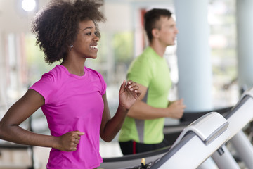 people exercisinng a cardio on treadmill Wall mural