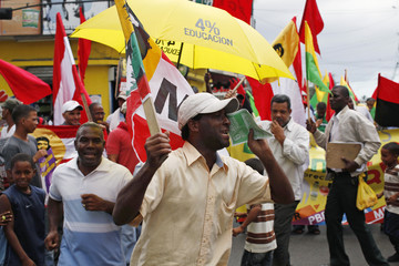A demonstrator shouts slogans during a rally in Santo Domingo
