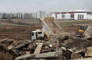 Trucks are pictured at the work site of the Parque Olimpico Rio 2016, which is being constructed over the former Jacarepagua race track, during a press tour in Rio de Janeiro