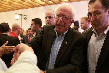 U.S. Democratic presidential candidate Bernie Sanders greets people during his visit to San Juan