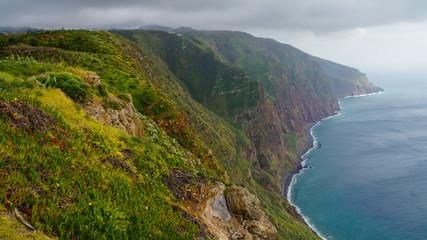 Madeira - Ponta do Pargo with green rocks and abrupt cliffs to the blue ocean