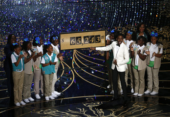 Show host Chris Rock reveals that $65,243.00 was raised when Girls Scouts sold cookies to the Oscars audience at the 88th Academy Awards in Hollywood