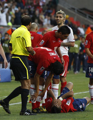 Switzerland's Valon Behrami looks at the referee Khalil Al Ghamdi after he was given a red card as Arturo Vidal recovers on ground during their 2010 World Cup Group H match in Port Elizabeth