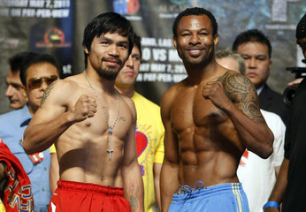 Manny Pacquiao of the Philippines poses with Shane Mosley of the U.S. during an official weigh-in at the MGM Grand Garden Arena in Las Vegas