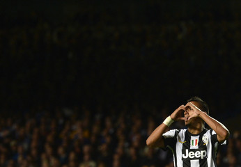 Juventus' Vidal celebrates after scoring a goal during their Champions League soccer match against Chelsea at Stamford Bridge in London