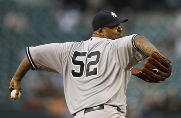 New York Yankees' Sabathia throws against the Baltimore Orioles in the first inning of their MLB baseball game in Baltimore