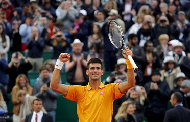 Djokovic of Serbia reacts after defeating Berdych of the Czech Republic during their final tennis match at the Monte Carlo Masters in Monaco