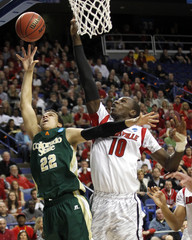 Colorado State's Green fights to get his shot off under pressure from University of Louisville' Dieng during the first half of their third round NCAA basketball game at Rupp Arena in Lexington