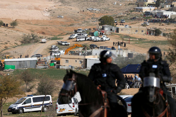 Mounted Israeli policemen are seen during clashes with Arab Israelis in Umm Al-Hiran, a Bedouin village in Israel's southern Negev Desert