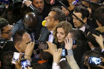 Former President Sarkozy and Kosciusko-Morizet arrive at a political rally in Paris