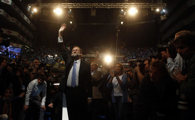 Rajoy, leader of centre-right People's Party (Partido Popular), waves to supporters at the start of his closing campaign rally in Madrid