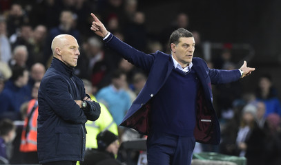Swansea City manager Bob Bradley and West Ham United manager Slaven Bilic