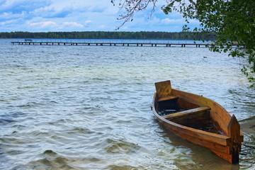 Fishing boat docked in the lake water. Landscape photo. Pisochne ozero. Volyn region